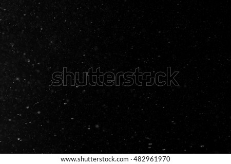 Blurred abstract background with particles on black background #482961970