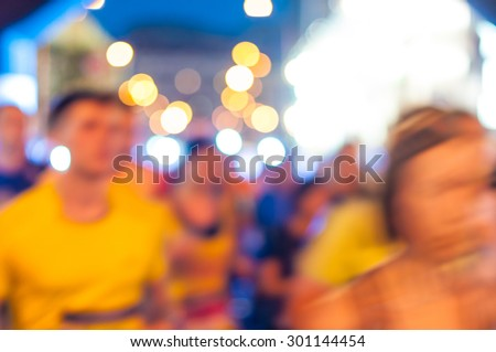 Blurred abstract crowd and Lights. Night marathon runners. Sport background.