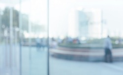 Blurred abstract glass wall from building in city town background.