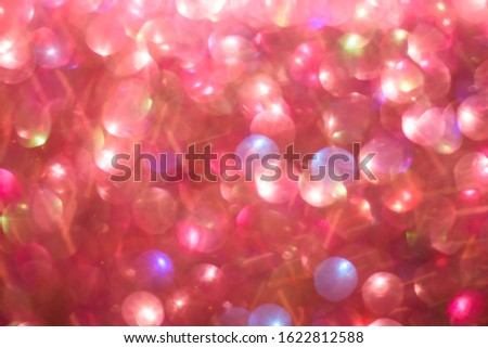 Blurred abstract red glitter bokeh, defocused lights. Holiday and Valentines day concept.