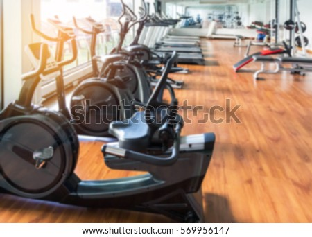 blurred abstract stationary bikes and health exercise equipment for bodybuilding in modern fitness center room