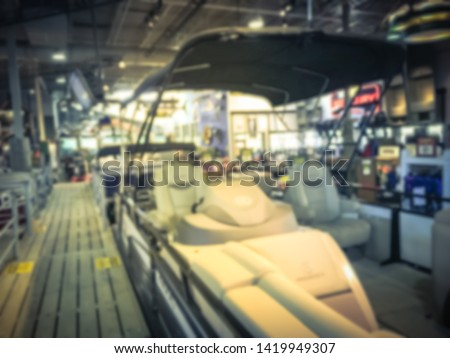 Blurred abstract variety of boat and ATV vehicles at showroom large outdoor store in Texas, America. Boat buying and servicing concept #1419949307