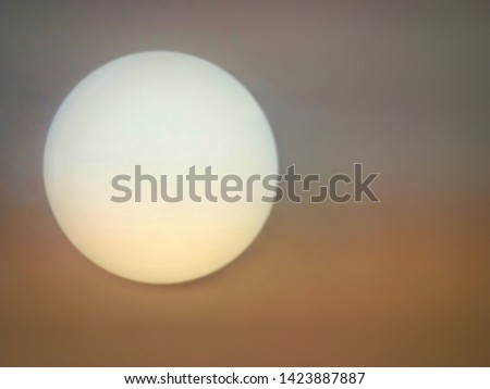 Blurred and defocused image of Glass globe shaped ball ceiling lamps on ceiling background.  Modern lamps, color change LED bulbs. Moon illustration concept. #1423887887