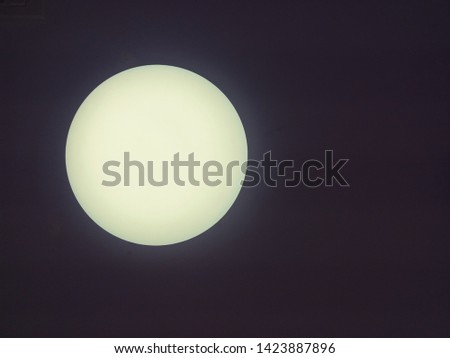 Blurred and defocused image of Glass globe shaped ball ceiling lamps on ceiling background.  Modern lamps, color change LED bulbs. Moon illustration concept. #1423887896