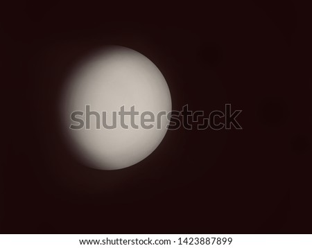 Blurred and defocused image of Glass globe shaped ball ceiling lamps on ceiling background.  Modern lamps, color change LED bulbs. Moon illustration concept. #1423887899