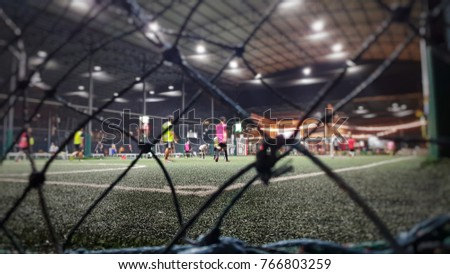 Blurred and selective focus of indoor soccer field on holiday at night time #766803259