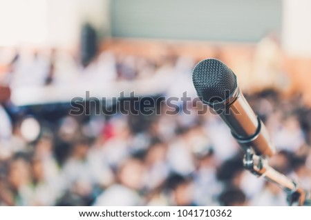 Blurred and Soft focus of head microphone on stage of Education meeting or event whit blurred background,Education meeting and event on stage concept and copy space #1041710362