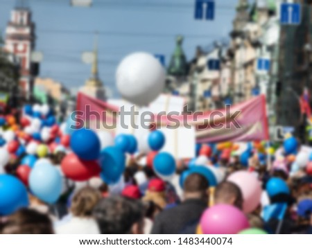 Blurred anonymous crowd in the metropolis. Festive crowd, street procession