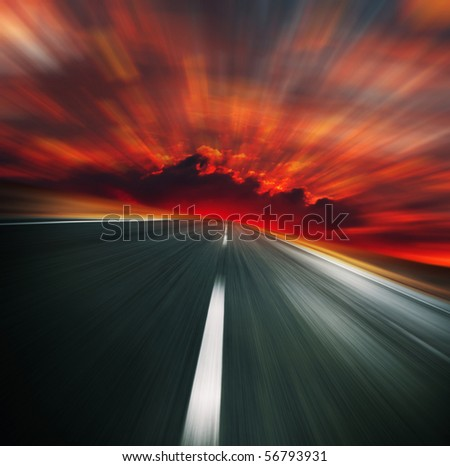 Blurred asphalt road and red bloody blurred sky