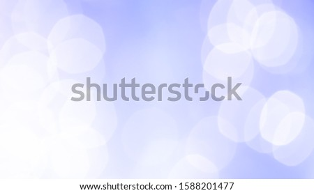 Blurred backdrop, blurred background, circle blur, bokeh blur from the light shining through as a backdrop and beautiful computer screen images.
