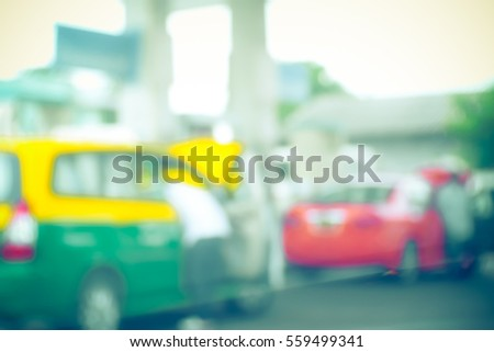 Blurred  background abstract and can be illustration to article of Petrol pump filling #559499341