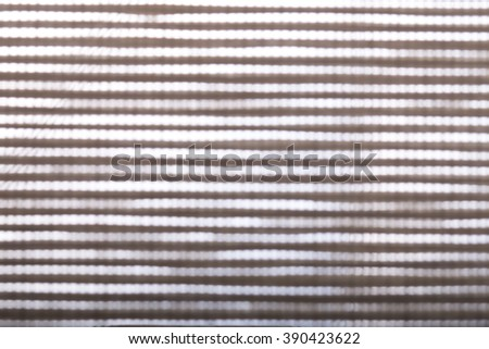 blurred background abstract. light gleaming through fabric. #390423622