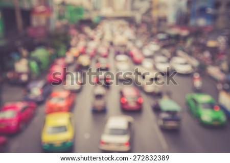 Blurred background : Blur of car and traffic jam in Bangkok, Thailand, vintage color