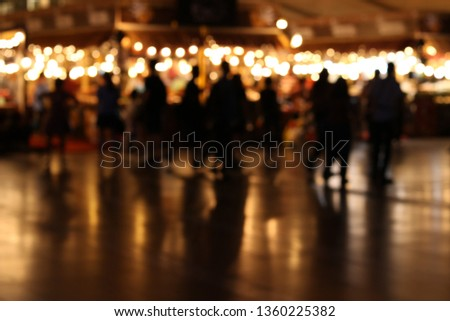 Blurred background. Blurred people shopping at night market. #1360225382