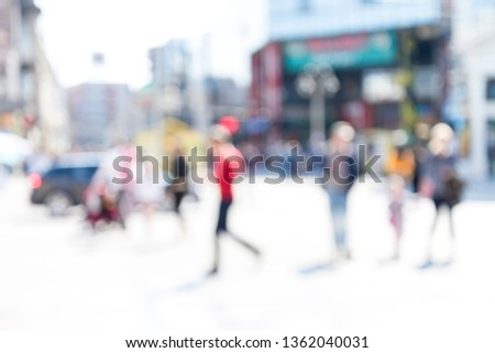 Blurred background. Blurred people walking through a city street. #1362040031
