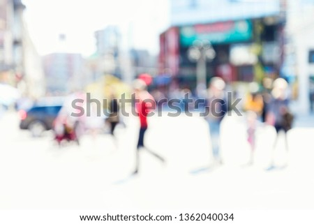 Blurred background. Blurred people walking through a city street. #1362040034