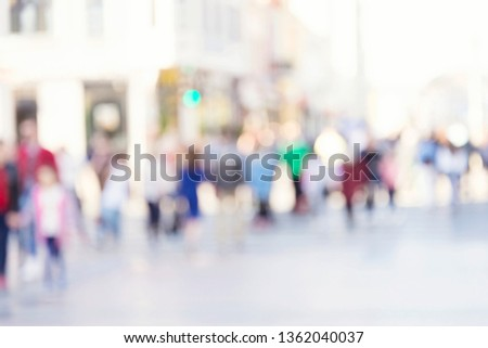 Blurred background. Blurred people walking through a city street. #1362040037