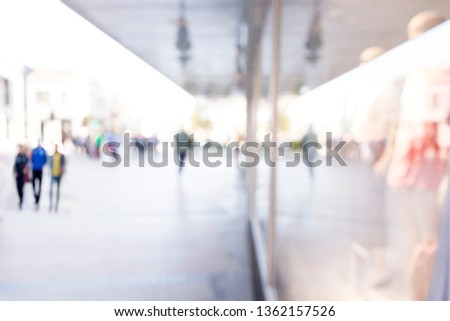 Blurred background. Blurred people walking through a city street. #1362157526