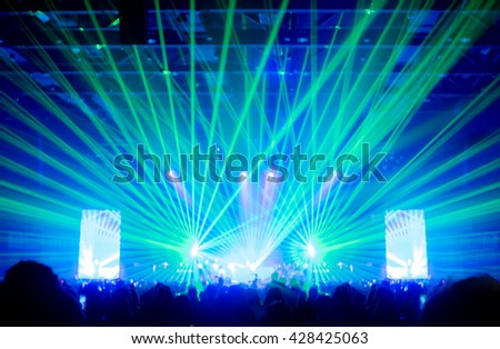 Blurred background,Bokeh lighting in concert with audience ,Music showbiz concept