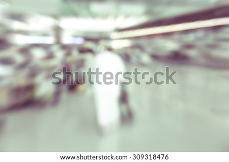 blurred background : business passenger in motion at airport terminal -  blur background concept