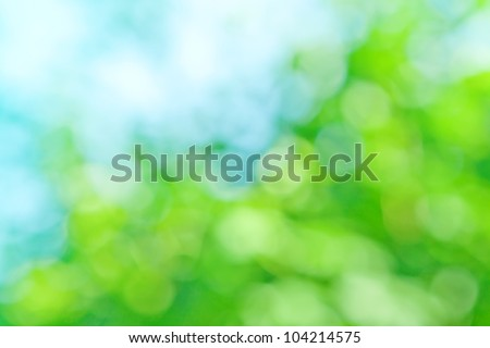 blurred background in natural spring green and blue colors, the bokeh effect
