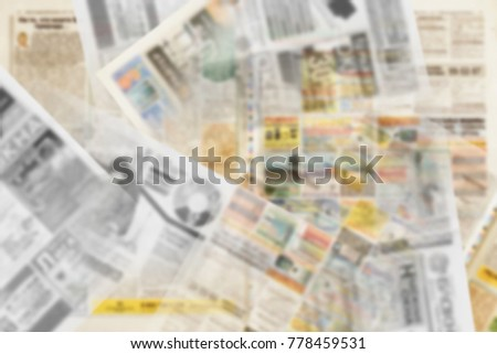 Blurred background made out of different pages of newspapers with headlines, photos and articles, texture #778459531