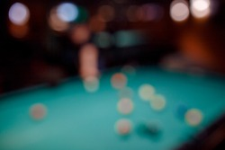 Blurred background men play snooker billiards on table balls