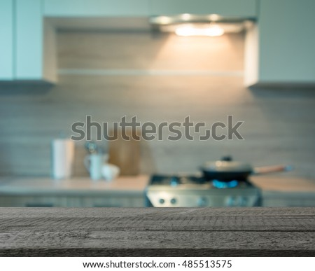 Photo of Blurred background. Modern kitchen with cooking on gas and space for you. Toned image.