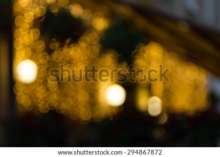 Blurred background night photo. Cityscape bokeh. De-focused abstract city. Background out of focus. Can use as wallpaper, design. Summer blurry city backdrop. Fairy de-focused photos.
