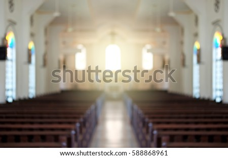 Blurred background of a surreal illuminated church aisle.