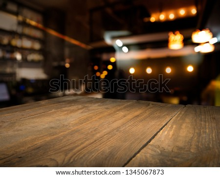 blurred background of bar and dark brown desk space of retro wood #1345067873
