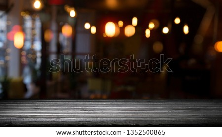 blurred background of bar and dark brown desk space of retro wood #1352500865