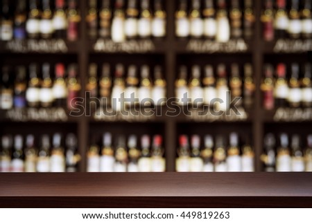 blurred background of bar and dark brown desk space of retro wood #449819263