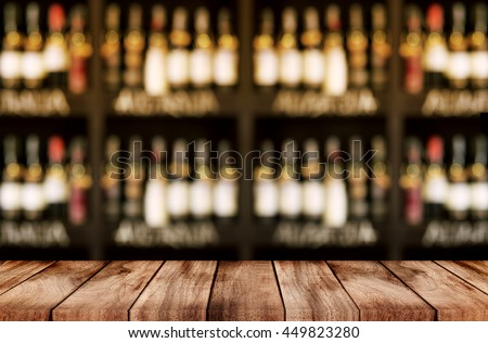 blurred background of bar and dark brown desk space of retro wood #449823280
