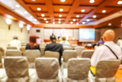 Blurred background of Business conference and presentation with audience at the conference room or seminar room.