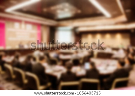 Blurred background of business people in conference hall or seminar room, business people concept. #1056403715