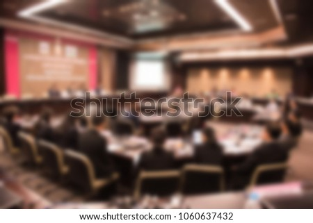 Blurred background of business people in conference hall or seminar room, business people concept. #1060637432