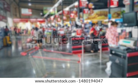 Blurred background of check-out counters of cashiesr row in a department store
