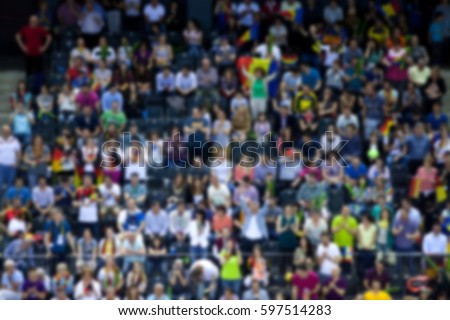 blurred background of crowd of people in a sports arena #597514283