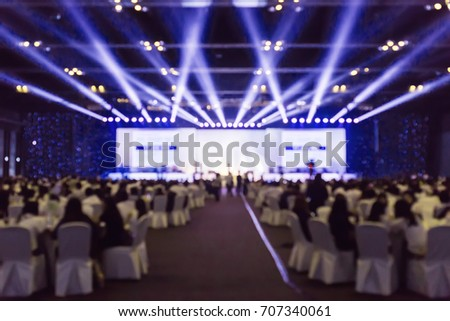 blurred background of event concert charity, blur of light on stage #707340061