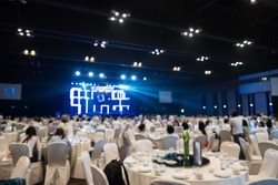 blurred background of event concert lighting at conference hall
