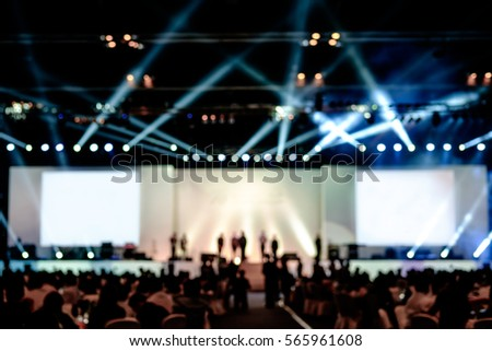 blurred background of event concert lighting at conference hall, spotlight with laser rays #565961608