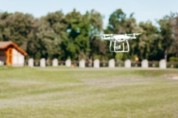 Blurred background of flying drone with camera on the sky