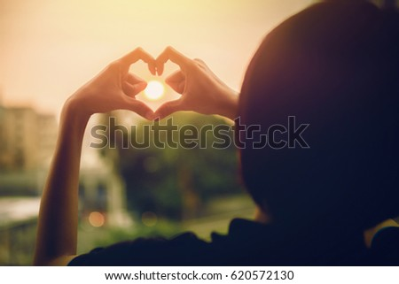 Blurred background of Girl in love enjoying the moments at sunset during holiday , Emotional concept of happy exclusive lifestyle moment, sharing time, relaxing with nature contact #620572130