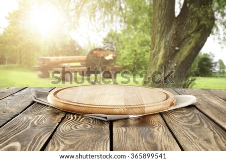 blurred background of grill time and summer wooden desk top  place