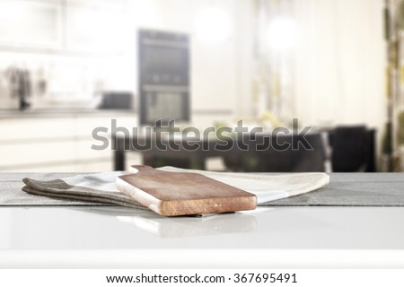 blurred background of kitchen interior and board of kitchen table and kitchen desk on napkin