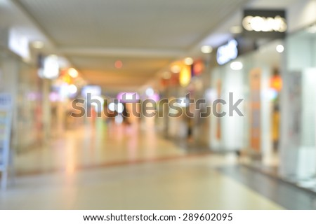 Blurred background of long corridor and showcase in shopping center