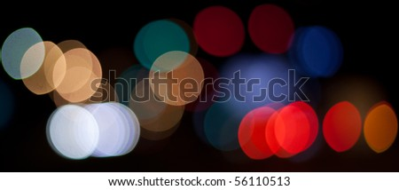 Blurred background of multicolored lights