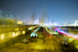 Blurred background of night Barcelona city lights, top view.