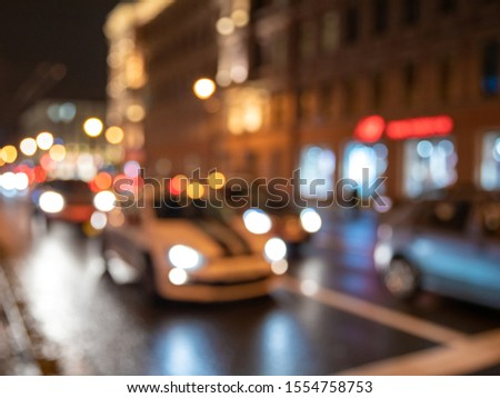 Blurred background of night city, road and headlights #1554758753